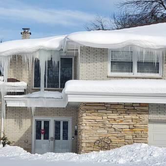 Ice Dam Icicles Build up on a Home in Grand Rapids Michigan